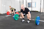 Group trains deadlift at fitness gym center — Stock Photo