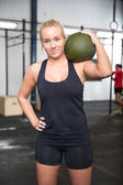 Woman with slam ball at fitness gym center — Stock Photo