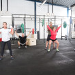 Team workout with weights at fitness gym center — Stock Photo #48364053