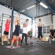 Team workout with kettlebells at fitness gym — Stock Photo #48365419