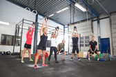 Team workout with kettlebells at fitness gym — Stock Photo