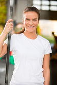 Happy young woman smiling at fitness gym center — Photo