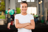 Confident and beautiful woman at fitness gym — Foto de Stock