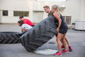 Flipping tractor tires as outdoor workout — Zdjęcie stockowe