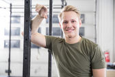 Smiling man rests in fitness gym center — Stock Photo