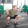 Squat workout at fitness gym center — Stock Photo #49086843