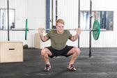 Squats training at fitness gym center — Stock Photo