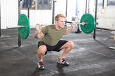 Squat workout at fitness gym center — Stock Photo