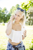 Beautiful teenage girl talking in the phone — Stok fotoğraf