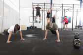 Workout group trains exercises at fitness gym — Stock Photo