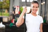 Smiling and attractive woman at fitness center — Stock Photo