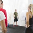 Personal trainer instructs fitness workout team — Stock Photo #51052793