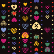 Hearts seamless pattern on dark background — Stock Vector