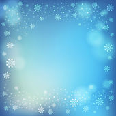 Winter snowflakes and soft highlights background. — Stock Vector