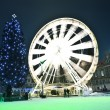 Moving circle luna park at christmas time — Stock Photo