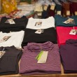 T shirts in the store — Stok fotoğraf