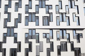 Office building with reflection on the windows from the sky — Stock Photo