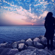 Woman standing in shadow in beautiful sunset — Stock Photo