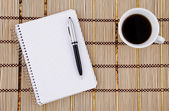 Notepad, pen and coffee mug. — Stock Photo