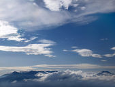 Mountains under clouds — Stock Photo