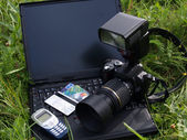 DIGITAL CAMERA and notebook. — Stock Photo