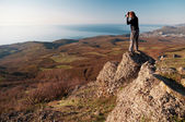 Photographer on the top of world — Стоковое фото