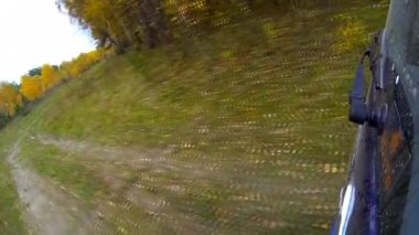 Driving a car through the countryside — Vídeo de stock