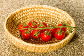Beautiful tomatos in a wooden basket — Stock Photo