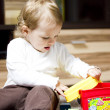 Baby playing on the floor — Stock Photo #27291007