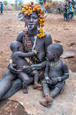 Omo Valley people - Mursi woman with children — Stock Photo