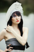 Beautiful girl in a hat — Stock Photo