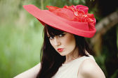 Attractive, beautiful, charming, desirable, disturbing, exciting, gentle, intriguing, playful, soft, stunning, sunny, sweet, warm brunette in a red hat with blue eyes romantic summer collection — Zdjęcie stockowe