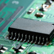 Black chip on circuit board — Stock Photo