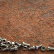 Screws collection on grunge background with copyspace — Stock Photo
