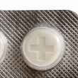 Close-up of pills marked by plus — Stock Photo