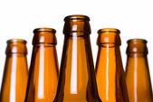 Stack of empty beer bottles — Stock Photo