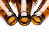 Three empty bottles over white — Stock Photo