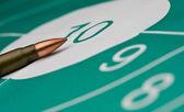 Cartridge and bullseye — Stock Photo