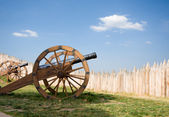 Ancient cannon battery in wooden fortress — Stock Photo
