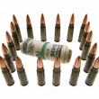 Banknotes roll and bullets — Stock Photo