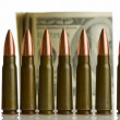 Cartridges and money - shallow DOF, focus on bullets — Stock Photo