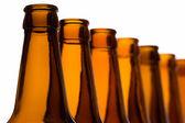 Bottles arranged in line — Stock Photo