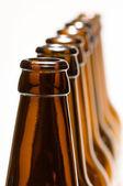 Line of bottles isolated on white — Stock Photo