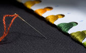 Needle and variegated threads set — Stock Photo