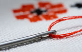 Macro of needle on criss-cross background — Stock Photo