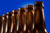 Brown bottles on blue background — Stock Photo