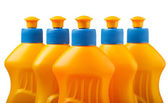 Dishwashing detergent yellow bottles — Stock Photo