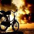 Sillhouette of bicycle at cloudy morning — Stock Photo #27580187