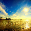 Sun star at morning on receding seshore — Stock Photo #27580235
