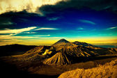 Bromo mountain under cloudy blue sky — Stock Photo